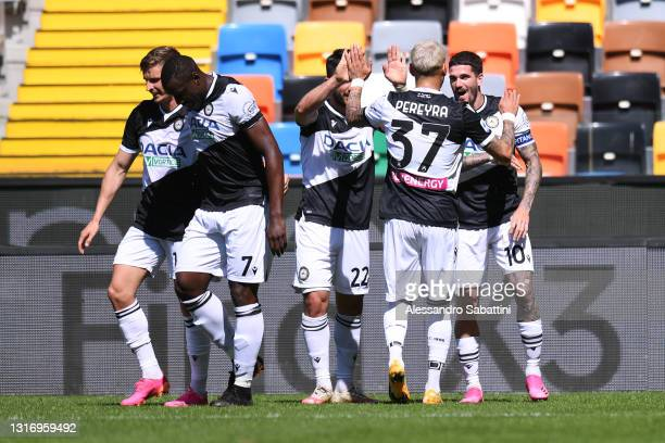 Rodrigo De Paul of Udinese Calcio celebrates after scoring their team's first goal with Tolgay Arslan and Roberto Pereyra during the Serie A match...