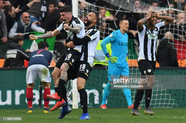 Rodrigo De Paul of Udinese Calcio celebrates with Sandro Raniere of Udinese Calcio during the Serie A match between Udinese and Bologna FC at Stadio...