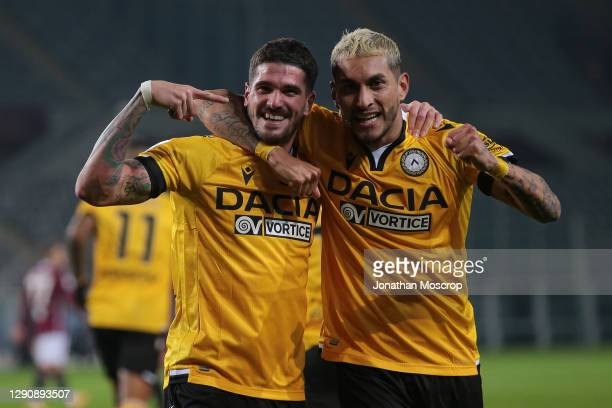 Rodrigo De Paul of Udinese Calcio celebrates with team mate Roberto Pereyra after scoring to give the side a 2-0 lead during the Serie A match...