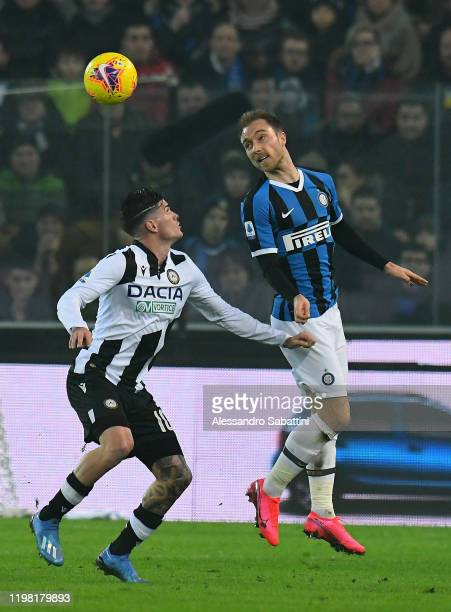 Rodrigo De Paul of Udinese Calcio competes for the ball with Christian Eriksen of FC Internazionale during the Serie A match between Udinese Calcio...