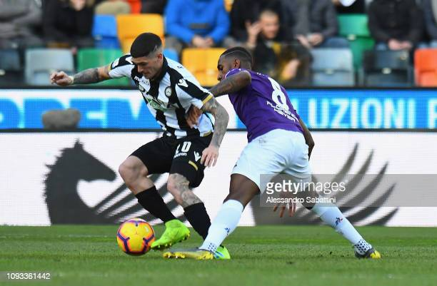 Rodrigo De Paul of Udinese Calcio competes for the ball with Gerson of ACF Fiorentina during the Serie A match between Udinese and ACF Fiorentina at...