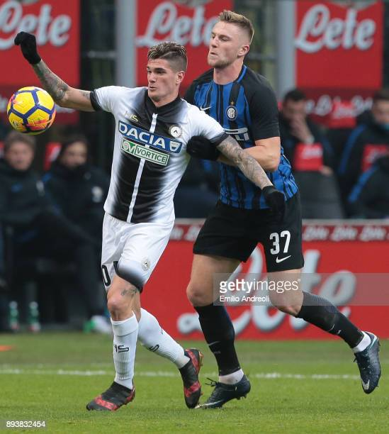 Rodrigo De Paul of Udinese Calcio competes for the ball with Milan Skriniar of FC Internazionale Milano during the Serie A match between FC...