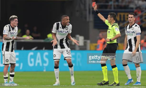 Rodrigo De Paul of Udinese Calcio receives a red card from referee Maurizio Mariani during the Serie A match between FC Internazionale and Udinese...