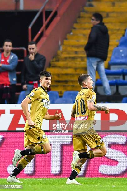 Rodrigo De Paul of Udinese celebrates with his teammate Ignacio Pussetto of Udinese after scoring a goal during the Serie A match between Genoa CFC...