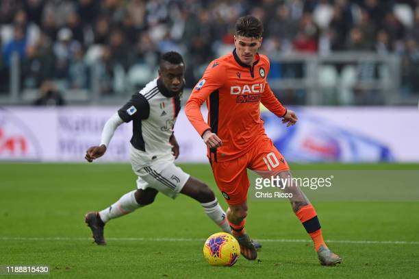 Rodrigo de Paul of Udinese evades a challenge from Blaise Matuidi of Juventus during the Serie A match between Juventus and Udinese Calcio at Allianz...