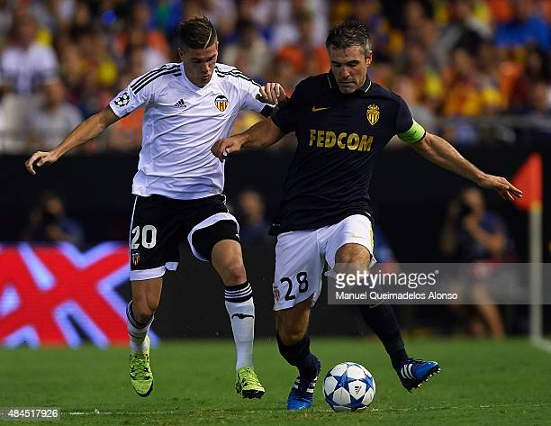 Rodrigo De Paul of Valencia battle for the ball with Jeremy Toulalan of Monaco during the UEFA Champions League Qualifying Round Play Off First Leg...