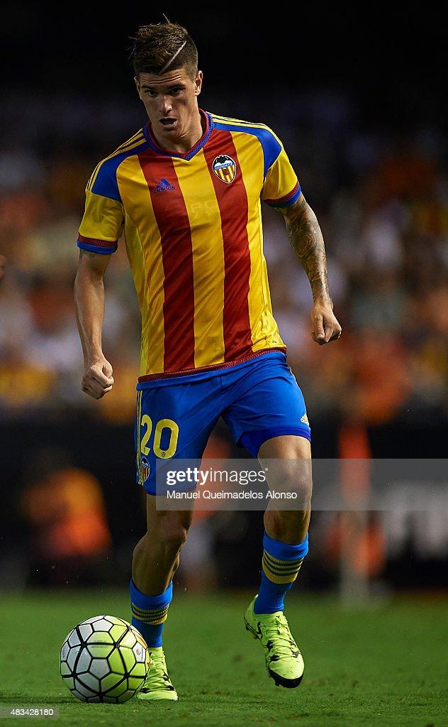 Rodrigo De Paul of Valencia runs with the ball during the pre-season friendly match between Valencia CF and AS Roma at Estadio Mestalla on August 8, 2015 in Valencia, Spain.