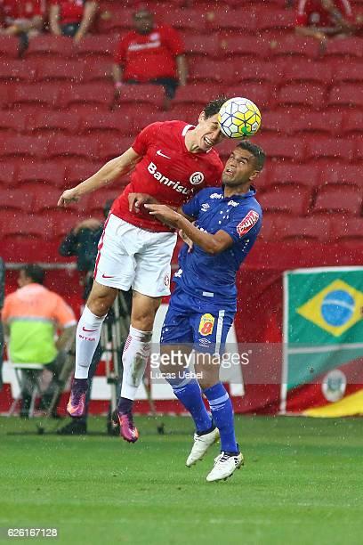 Rodrigo Dourado of Internacional battles for the ball against Alisson of Cruzeiro during the match between Internacional and Cruzeiro as part of...