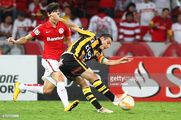Rodrigo Dourado of Internacional battles for the ball against Pablo Escobar of The Strongest during match between Internacional and The Strongest as...