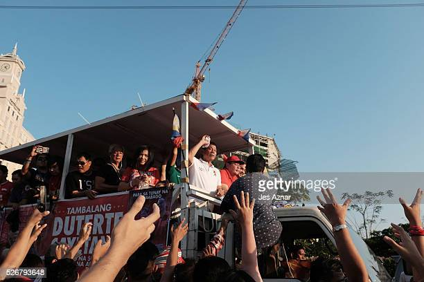 Rodrigo Duterte and his supporters onboard a truck during a campaign motorcade on May 1 2016 in Manila Philippines Presidential Candidate Rodrigo...