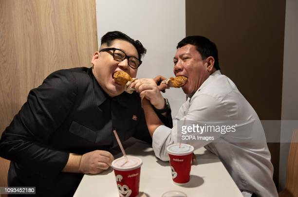 Rodrigo Duterte and Kim Jongun impersonators seen eating lunch in a filipino fast food Jollibee chain restaurant in Cental Hong Kong The...