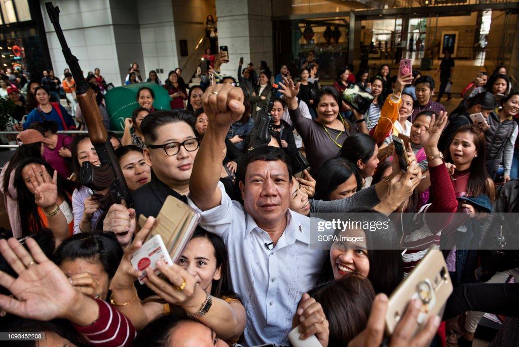 Rodrigo Duterte and Kim Jong-un impersonators seen greeting... : News Photo