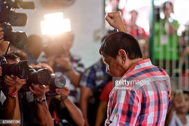 Rodrigo Duterte Mayor of Davao and presidential candidate gestures to members of the media at a polling station during the presidential election in...
