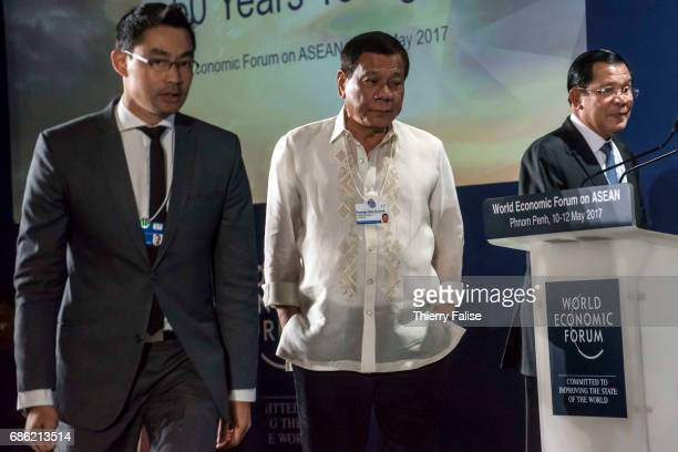 Rodrigo Duterte president of the Philippines and Hun Sen prime minister of Cambodia walk at the opening ceremony of the 2017 World Economic Forum on...