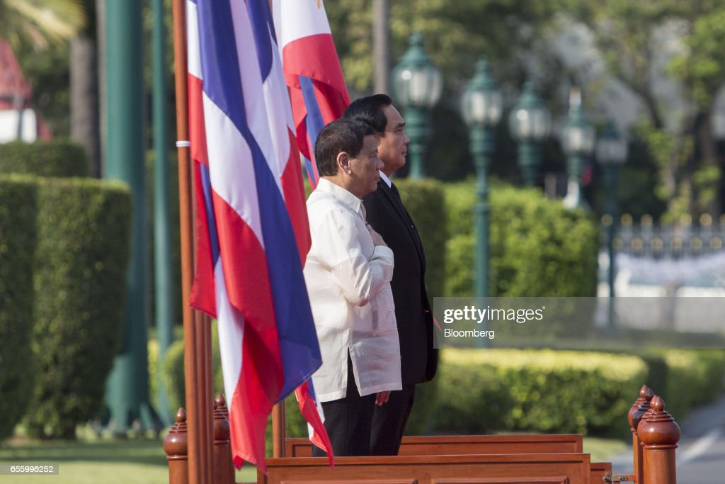 Rodrigo Duterte, the Philippines' president, left, and Prayuth Chan-Ocha, Thailand's prime minister, salute ahead of a news conference at Government House in Bangkok, Thailand, on Tuesday, March 21, 2017. Duterte returns to the Philippines on March 22. Photographer: Brent Lewin/Bloomberg via Getty Images