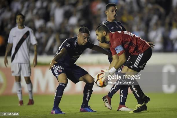 Rodrigo Echeverría and Johnny Herrera of Universidad de Chile in action during a Group Stage match between Vasco and Universidad de Chile as part of...