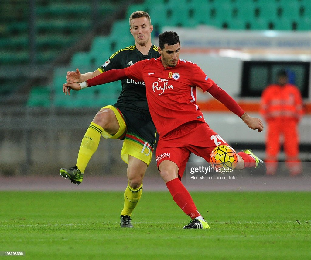 Rodrigo Ely of AC Milan competes for the ball with Antonis Petropoulos during a pre-season tournament between FC Internazionale, AC Milan and AS Bari at Stadio San Nicola on November 24, 2015 in Bari, Italy.
