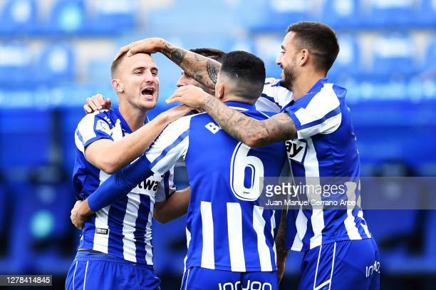 Rodrigo Ely of Deportivo Alaves celebrates with his team after he scores his sides first goal during the La Liga Santander match between Alaves and...