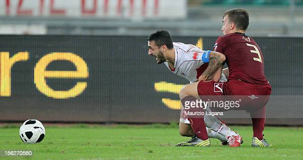 Rodrigo Ely of Reggina competes for the ball with Francesco Caputo of Bari during the Serie B match between AS Bari and Reggina Calcio at Stadio San...