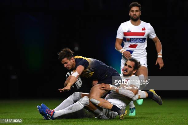 Rodrigo Etchart of Argentina is tackled by Jonathan Laugel of France during the Rugby X at The O2 Arena on October 29 2019 in London England