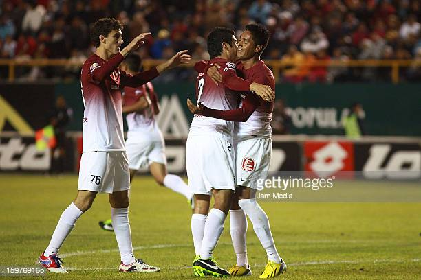 Rodrigo Godinez Enrique Perez and Sergio Santana of Morelia celebrate a goal against San Luis during a match between San Luis and Morelia as part of...