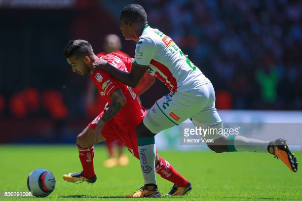 Rodrigo Gomez of Toluca struggles for the ball with Brayan Beckeles of Necaxa during the fifth round match between Toluca and Necaxa as part of the...