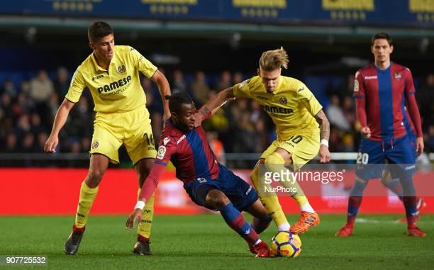 Rodrigo Hernandez and Samu Castillejo of Villarreal CF and Cheick Doukoure of Levante Union Deportiva during the La Liga match between Villarreal CF...