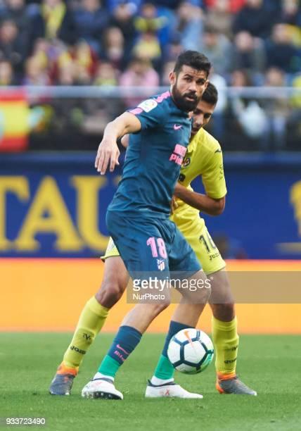 Rodrigo Hernandez of Villarreal and Diego Costa of Atletico de Madrid during the La Liga match between Villarreal and Atletico de Madrid at Estadio...
