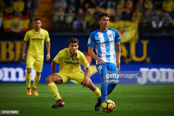 Rodrigo Hernandez of Villarreal CF and Adalberto Penaranda of Malaga CF in action during the La Liga match between Villarreal CF and Malaga CF at...