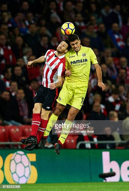 Rodrigo Hernandez of Villarreal CF competes for the ball with Aritz Aduriz of Athletic Club during the La Liga match between Athletic Club Bilbao and...