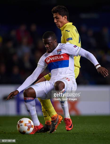 Rodrigo Hernandez of Villarreal competes for the ball with Tanguy Ndombele of Olympique Lyon during UEFA Europa League Round of 32 match between...