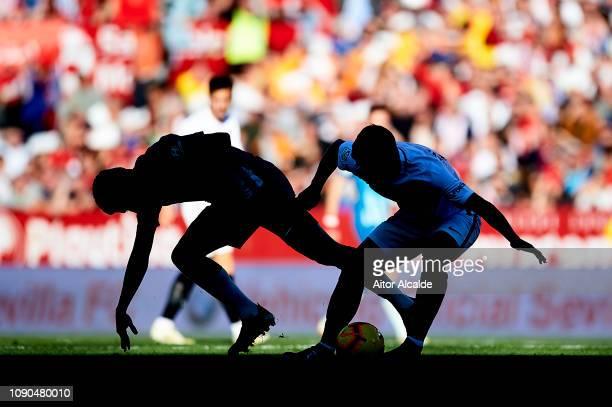 Rodrigo Hernandez 'Rodri' of Club Atletico de Madrid competes for the ball with Ever Banegan of Sevilla FC during the La Liga match between Sevilla...