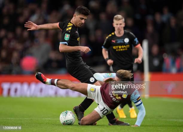 Rodrigo Hernández Cascante Rodri of Manchester City and Jack Grealish of Aston Villa during the Carabao Cup Final between Aston Villa and Manchester...
