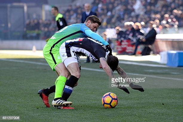 Rodrigo Javier De Paul of Udinese Calcio competes with Cristian Ansaldi of FC Internazionale during the Serie A match between Udinese Calcio and FC...