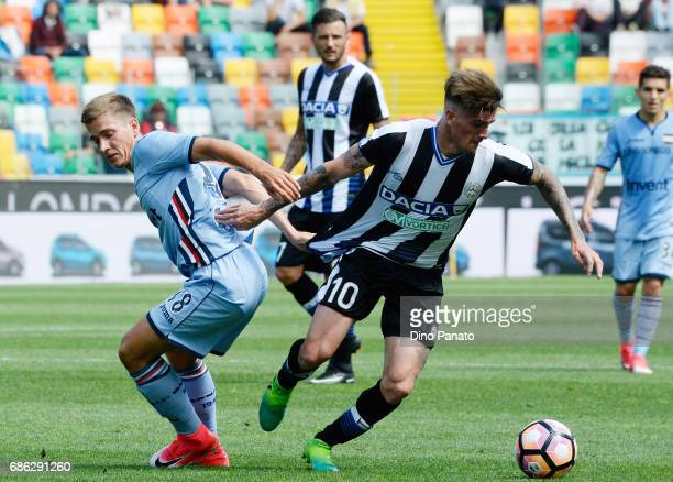 Rodrigo Javier De Paul of Udinese Calcio competes with Dennis Praet of UC Sampdoria during the Serie A match between Udinese Calcio and UC Sampdoria...