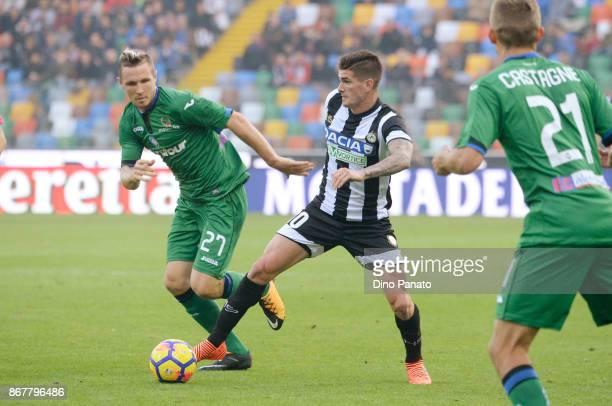 Rodrigo Javier De Paul of Udinese Calcio competes with Jasmin Kurtic of Atalanta BC during the Serie A match between Udinese Calcio and Atalanta BC...