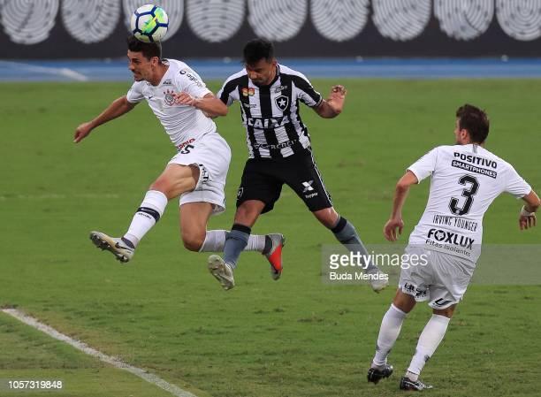 Rodrigo Lindoso of Botafogo struggles for the ball with Danilo Avelar of Corinthians during a match between Botafogo and Corinthians as part of...