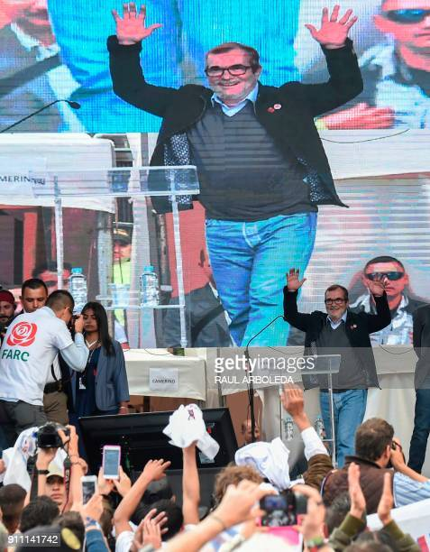 Rodrigo Londono Echeverri known as 'Timochenko' the presidential candidate for the Common Alternative Revolutionary Force political party greets his...