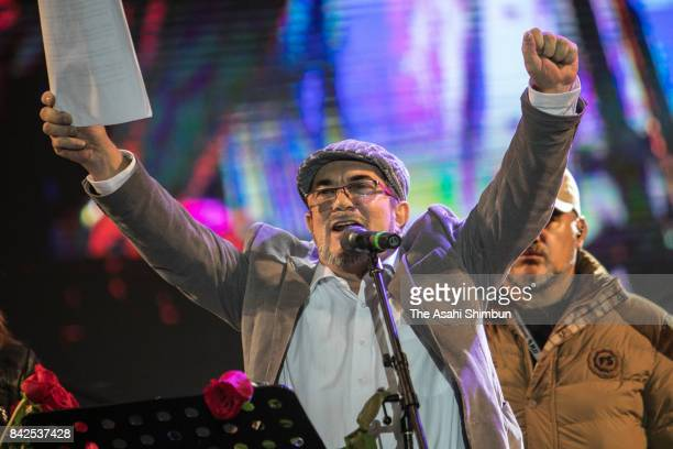 Rodrigo Londono or commonly known as Timoleon Jimenez leader of disarmed guerrilla group Revolutionary Armed Forces of Colombia celebrates its...