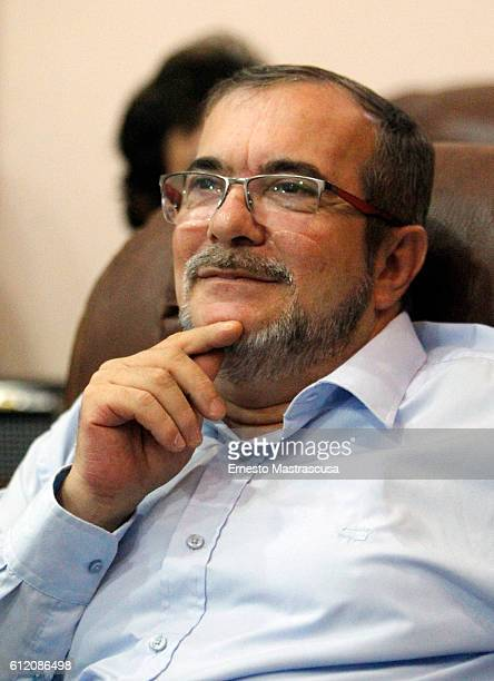 Rodrigo Londoño Echeverri also known as Timochenko and Timoleón Jimenez the top leader of the Revolutionary Armed Forces of Colombia FARC looks on...