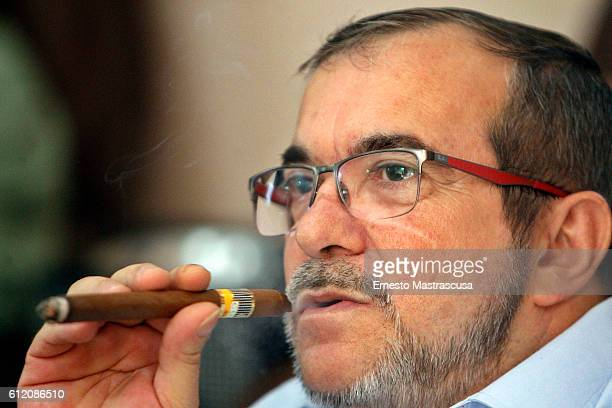Rodrigo Londoño Echeverri also known as Timochenko and Timoleón Jimenez the top leader of the Revolutionary Armed Forces of Colombia FARC smokes a...