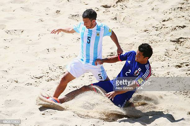 Rodrigo Lopez of Argentina is challenged by Takuya Akaguma of Japan during the FIFA Beach Soccer World Cup Portugal 2015 Group A match between Japan...