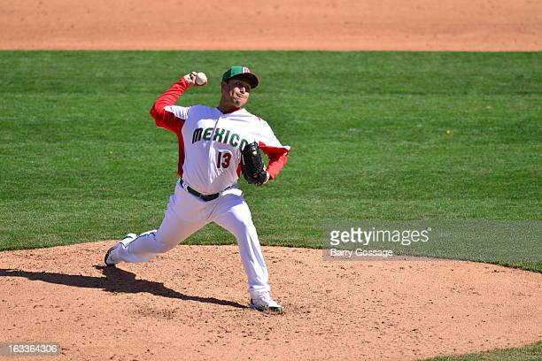 Rodrigo Lopez of Team Mexico pitches during Pool D Game 1 between Italy and Mexico in the first round of the 2013 World Baseball Classic at Salt...