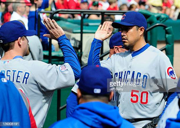 Rodrigo Lopez of the Chicago Cubs high fives Ryan Dempster during a game against the St Louis Cardinals at Busch Stadium on September 24 2011 in St...