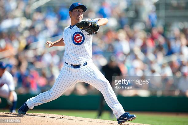 Rodrigo Lopez of the Chicago Cubs pitches during a spring training game against the Oakland Athletics at HoHoKam Stadium on March 4 2012 in Mesa...
