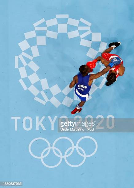 Rodrigo Marte de la Rosa of Dominican Republic exchanges punches with Tetteh Sulemanu of Ghana during the Men's Fly on day three of the Tokyo 2020...