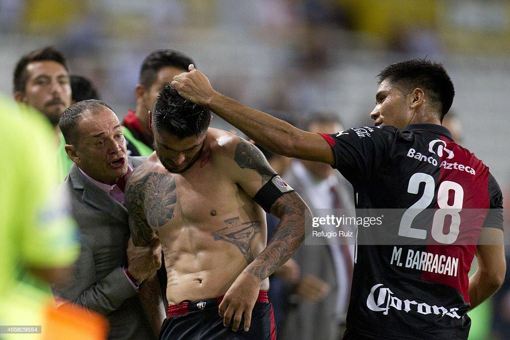 Rodrigo Millar of Atlas celebrates after scoring the winning goal during a match between Atlas and Cruz Azul as part of 9th round Apertura 2014 Liga MX at Jalisco Stadium on September 20, 2014 in Guadalajara, Mexico.