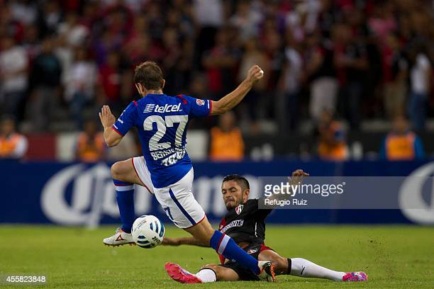Rodrigo Millar of Atlas fights for the ball with Hernan Bernardello of Cruz Azul during a match between Atlas and Cruz Azul as part of 9th round...