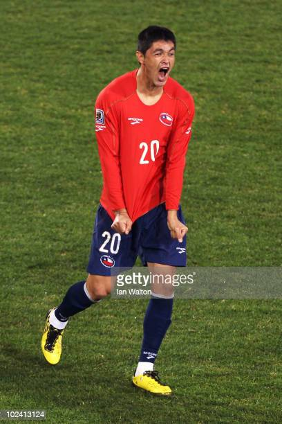 Rodrigo Millar of Chile celebrates scoring his team's first goal during the 2010 FIFA World Cup South Africa Group H match between Chile and Spain at...