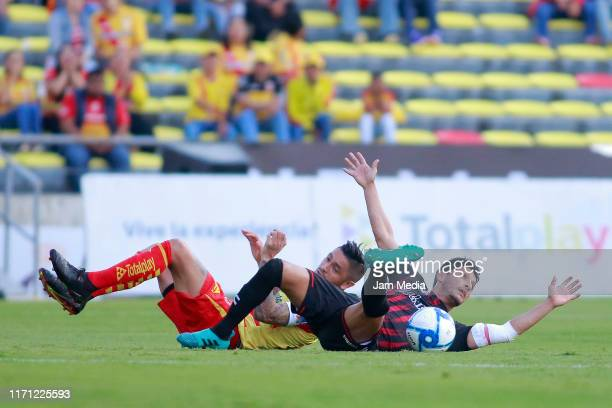 Rodrigo Millar of Morelia fights for the ball with Angel Reyna of Veracruz during the 8th round match between Morelia and Veracruz as part of the...